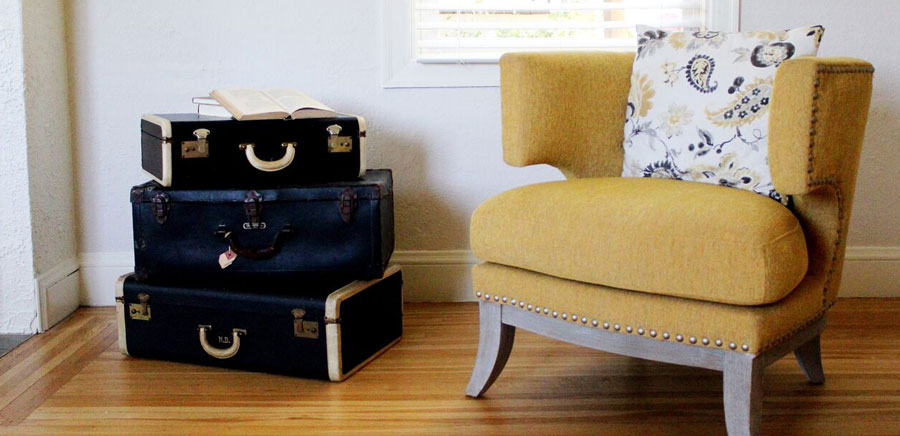 enjoying home yellow chair suitcases